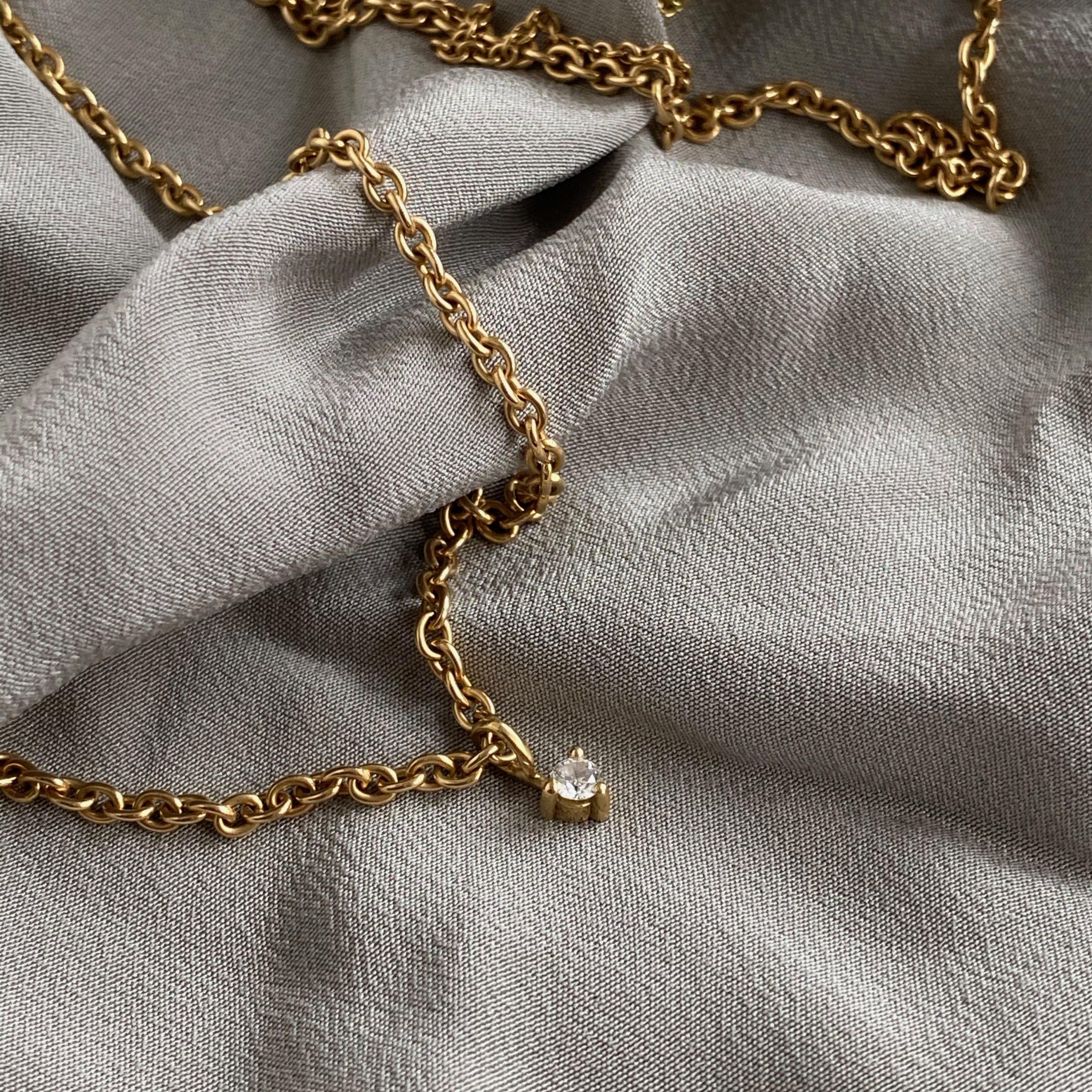 Diamond Pendant on a Long Gold Chain
